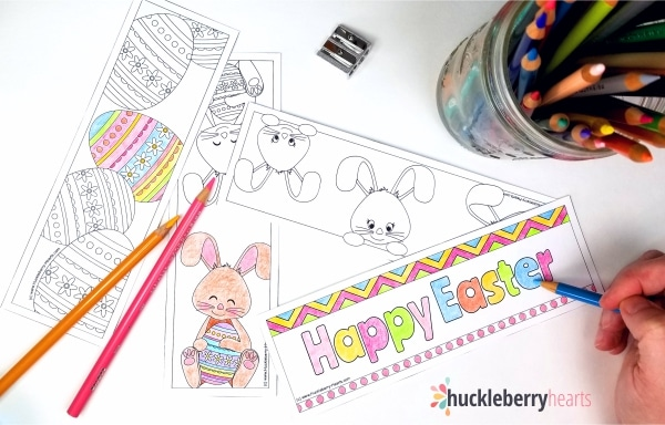 Hand coloring easter bookmarks with colored pencils